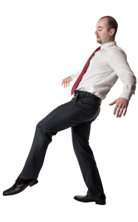 funny guys: man try to balance himself isolated on white Stock Photo
