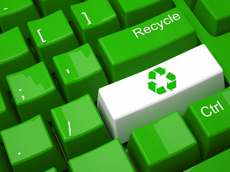 metal recycling: Green recycling on modern  keyboard Stock Photo