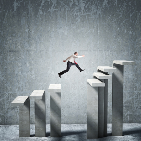 try: jumping businessman on  concrete stair