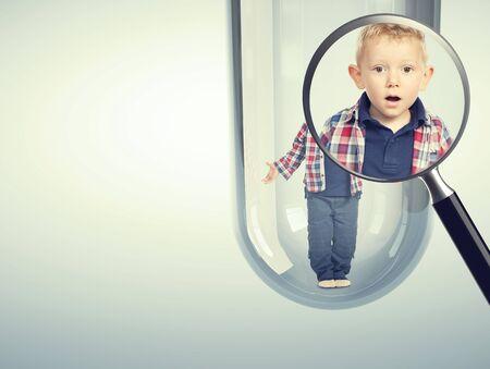 fertilization: surprised child and tube vitro glass