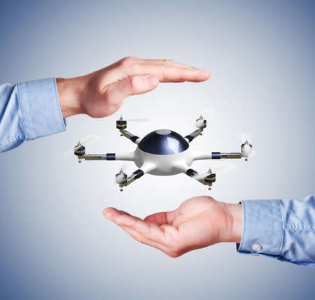 human hands: modern 3d drone and human hands Stock Photo
