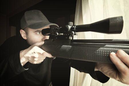 sniper: portrait of caucasian sniper with rifle Stock Photo
