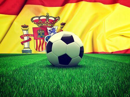 spain: soccer ball on grass and spain flag Stock Photo