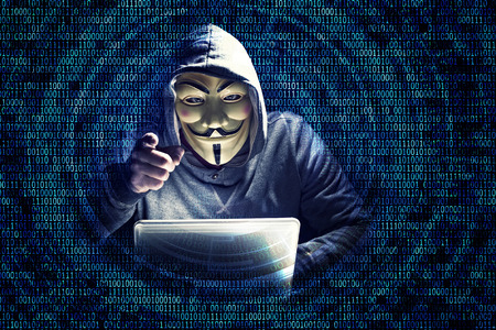 portrait of hacker with mask and binary code background
