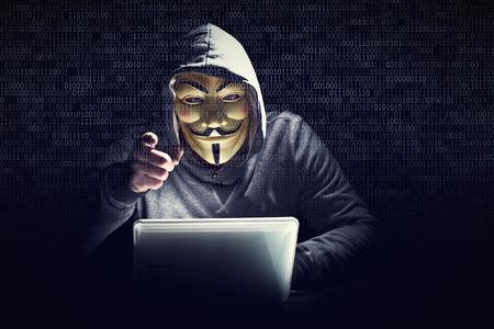 stolen identity: hacker portrait and binary code background