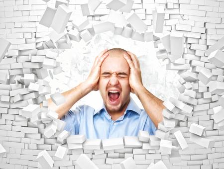 pared rota: hombre desesperado y pared de ladrillos rotos 3d Foto de archivo