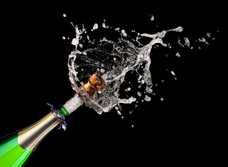 popping: popping champagne on black background