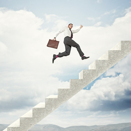 businessman go up on abstract 3d stair photo