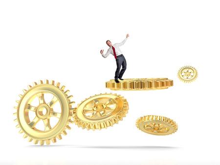 businessman balance himself on gold gear part