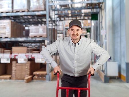 caucasian delivery man in warehouse photo