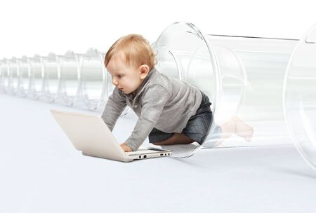 netbooks: little child with pc and test tube vitro concept of modern kid Stock Photo