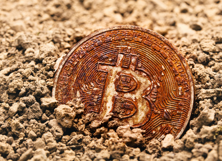 bitcoin virtual payment system buried in ground rusty and old