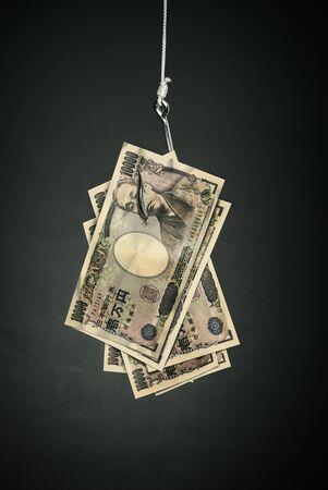 business metaphore: yen money on hook economy concept
