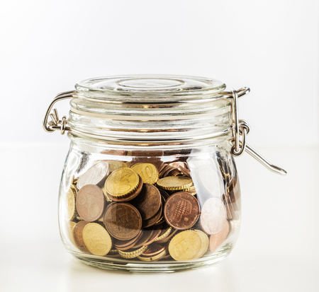 euro coin in classic glass jar