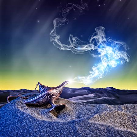 砂漠の夜のシーンで古典的なアラジンの魔法のランプ 写真素材
