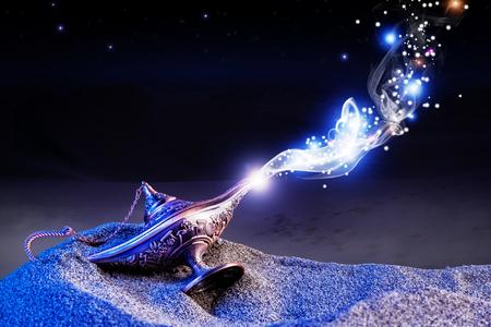 aladdin genie magic lamp on desert sand Standard-Bild