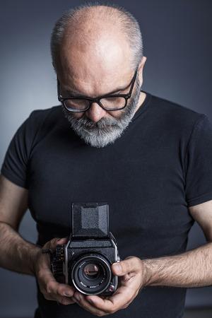 photographer with medium format film  camera Stock Photo