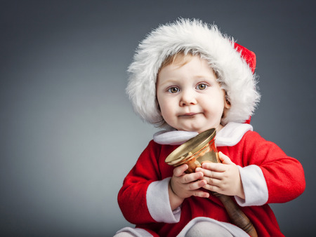 portrait of cute female caucasian child with santa claus clothes Stock Photo