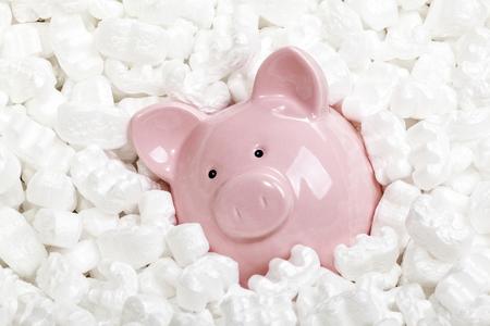 piggybank and polystyrene peanuts background 스톡 콘텐츠