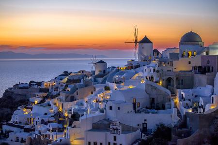 sunset view of oia in santorini greece