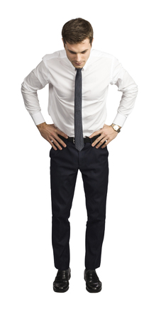 young caucasian businessman look down isolated on white background Stock Photo