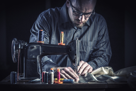 tailor work with sewing machine vintage style Zdjęcie Seryjne
