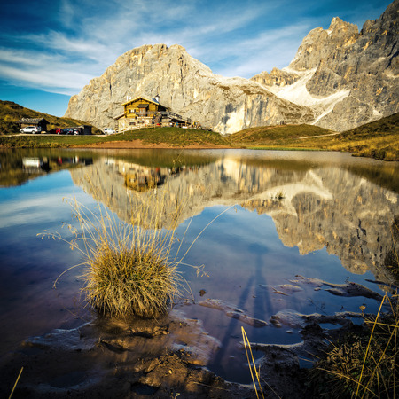 Reflection in Passo Rolle, Italian alps, Pale Di San Martino Фото со стока