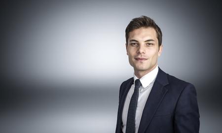 image of caucasian businessman studio shot on grey background