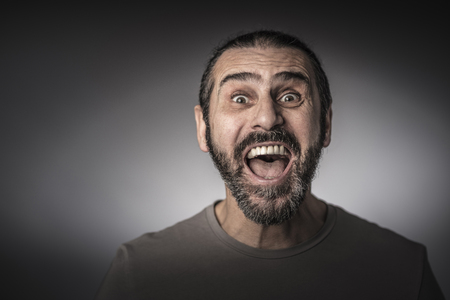 portrait of surprised man studio shot grey background