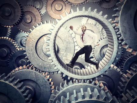 running businessman in huge abstract gear