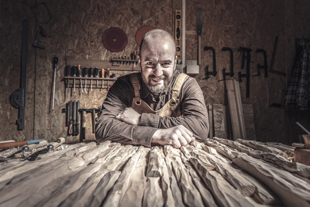portrait of smiling carpenter in a workshop