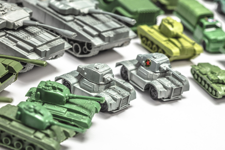 detail of old plastic toys, reproductions of military weapons such as jeeps and armored tanks.
