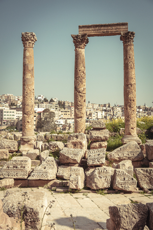 ancient columns in the citadel of Amman, old city in the background. Jordan.
