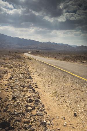 paved road in the Jordanian desert of Wadi Rum. Stok Fotoğraf