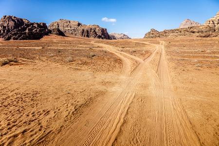 track in the desert of Wadi Rum, Jordan. Tire tracks on the sand.