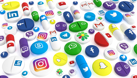Milan, Italy - May 27, 2019: Pills of various types and sizes bearing the logo of the most famous social networks. 3d image render. Editorial illustration. Stock Illustration - 124479709