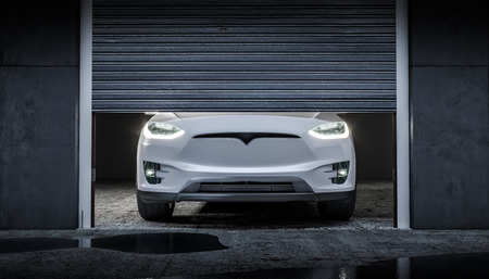 Modern electric machine with the headlights on and located in a garage with a half-lift damper. 3d render Stok Fotoğraf