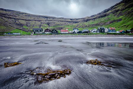 View from the beach of the fishing town of Tjørnuvík, in the Faroe Islands.