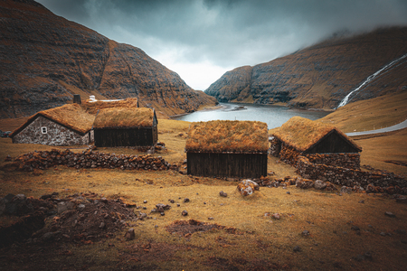 famous old houses with grass roofs in Saksun on the Faroe Islands. Stok Fotoğraf