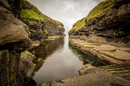 view of the famous port among the cliffs of Gjogv on the Faroe Islands.