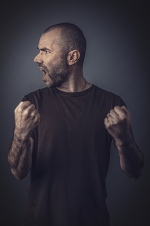 Satisfied and happy man posing with clenched fists as a sign of success. Stok Fotoğraf