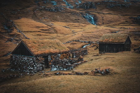 Houses with grass roofs in the village of Saksun on the Faroe Islands. Stok Fotoğraf