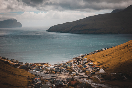 Typical view of the Tjornuvik village on the Faroe Islands. Ocean in the background.