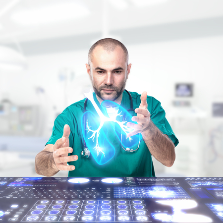 Doctor uses augmented reality to analyze anatomical parts. Advanced technology concept in medical use.