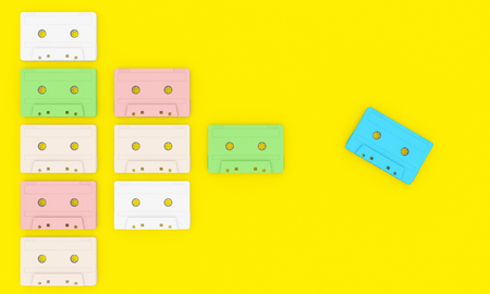 3d render of different vintage audio cassettes. flat lay style