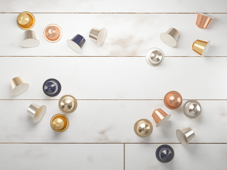 3d render of several espresso coffee capsules on a white wooden background. Stok Fotoğraf