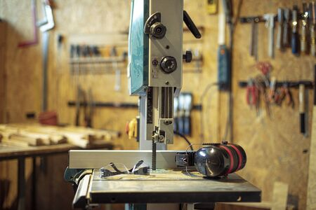 detail of carpenter tool bandsaw in workshop Stock Photo