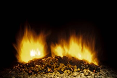 detail of wood pellets burning in a stove. Concept of heating and biomass.