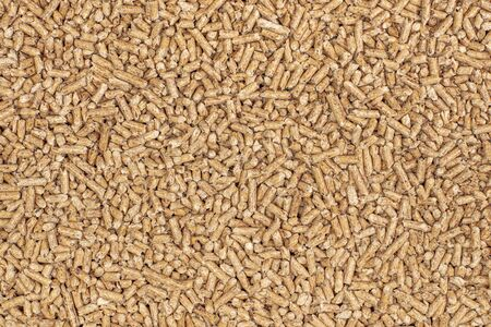 detail of multiple wood pellets used as natural fuel to fuel stoves and boilers. Stockfoto