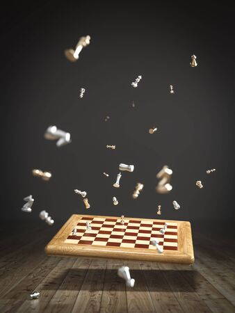 Chessboard falling on the wooden floor, scattered and flying game pieces.